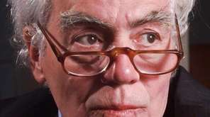 Journalist and author Jimmy Breslin poses for a