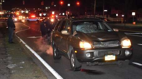 Suffolk County police investigate scene where a sport