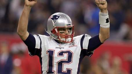 New England Patriots' Tom Brady reacts after a