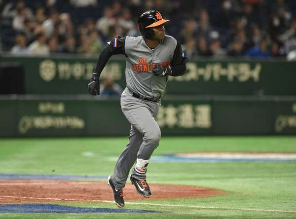 Netherlands' Didi Gregorius runs the bases following his three-run