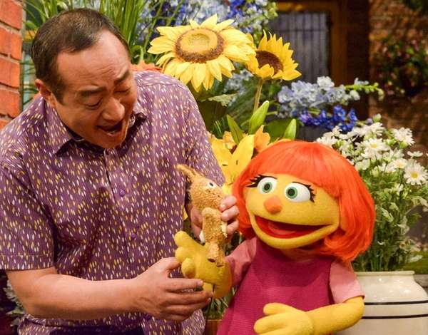 Julia, right, is a new autistic Muppet character