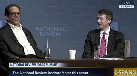 Columnist Charles Krauthammer, left, speaks with National Review