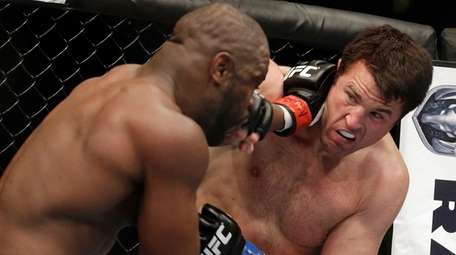 Rashad Evans, left, and Chael Sonnen trade punches