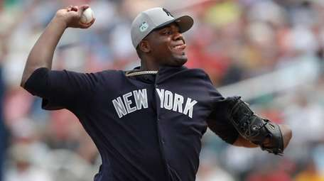 New York Yankees starting pitcher Michael Pineda works