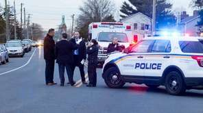 Police investigate a shooting on Front Street near