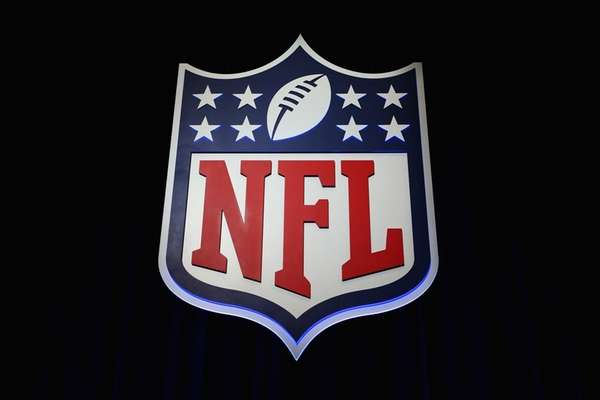 The NFL shield logo is seen following a