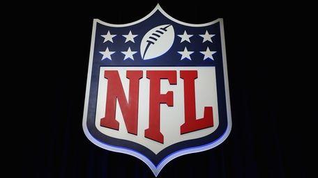 The NFL shield logo is seen following a