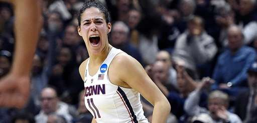Connecticut's Kia Nurse reacts after hitting a 3-point