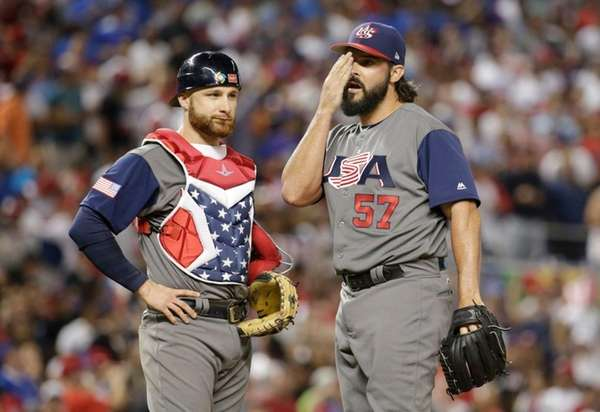 U.S. relief pitcher Tanner Roark stands on the