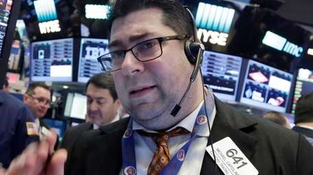 Trader Michael Capolino works on the floor of