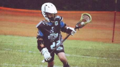 Kidsday reporter Robbie Urban plays lacrosse for a