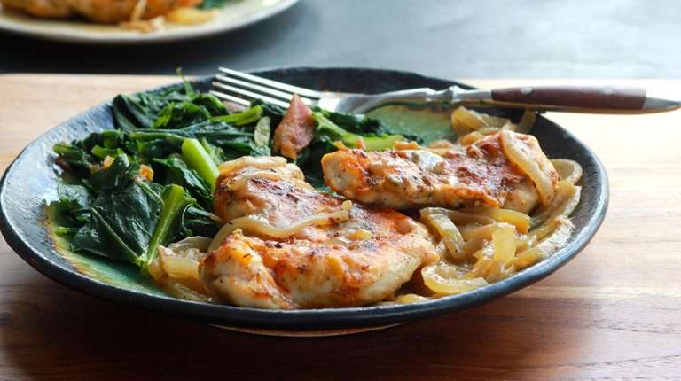 Chicken breasts are pan seared and served smothered