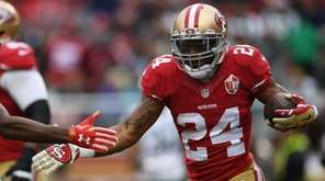 Shaun Draughn of the San Francisco 49ers celebrates