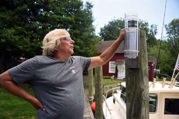 Barry Dlouhy, a volunteer weather watcher, uses a