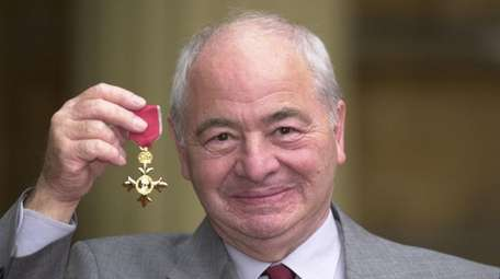 British author Colin Dexter after receiving an Order
