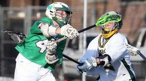 Farmingdale's Joe Siomons scores during a Nassau boys