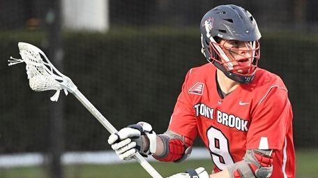 Stony Brook attacker Ryan Bitzer looks to pass