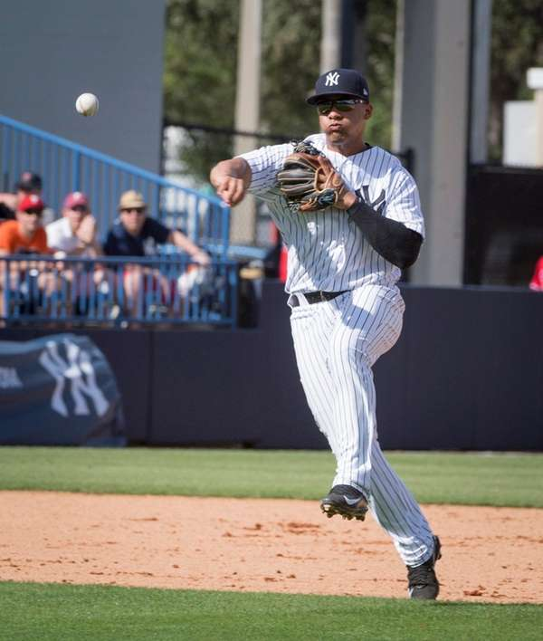 New York Yankees' Gleyber Torres throwing to first