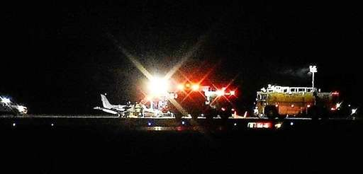 A twin-engine plane landed hard on its belly