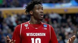 Nigel Hayes of the Wisconsin Badgers reacts after