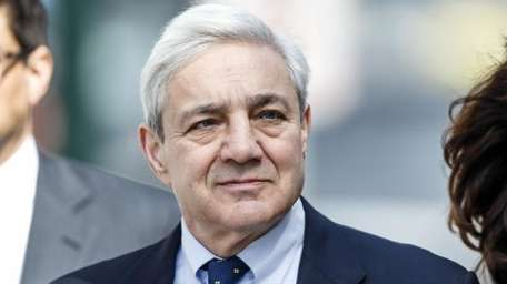 Former Penn State president Graham Spanier walks back