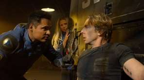 Michael Peña, left, Kristen Bell and Dax Shepard
