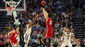 Wisconsin guard Bronson Koenig (24) takes a three-point