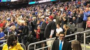 Fans look on during practice as Kansas takes