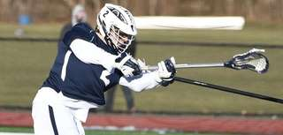 Smithtown West attacker Dan Riley shoots to score