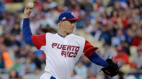 Puerto Rico pitcher Seth Lugo throws against the