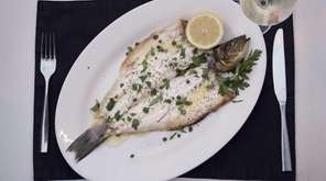 The Lavraki, or whole branzino, is a specialty