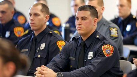Police recruit Matias Ferreira, 28, Marine veteran, sits