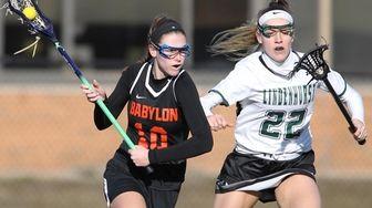 Lindenhurst's Annie Gigante (10) moves the ball while
