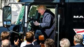 President Donald Trump gets in the driver's seat