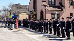FDNY members line up to honor family members