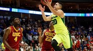 Baylor guard Manu Lecomte goes for a layup