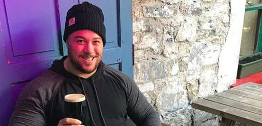 Christopher Dell'Isola enjoys a pint while recovering from