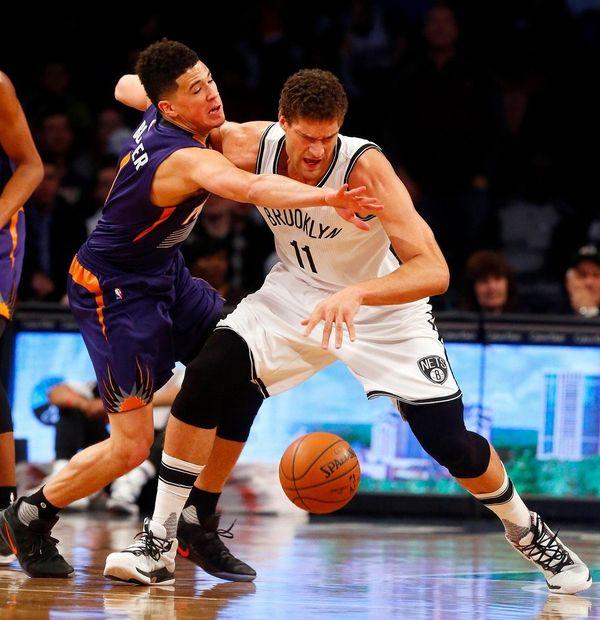 Brook Lopez, #11, of the Brooklyn Nets battles