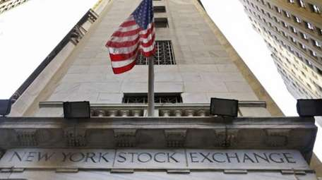 The American flag flies above the Wall Street