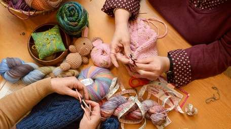 Ruth Kerekes (left), of Stony Brook, practices knitting