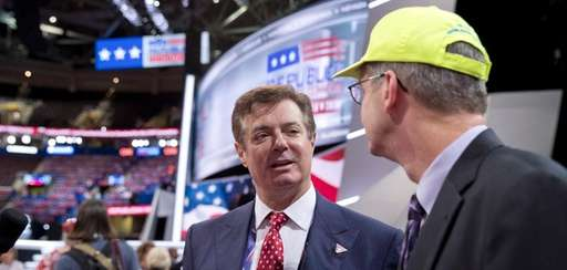 Trump campaign chairman Paul Manafort talks to delegates