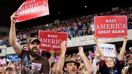 Supporters cheer for President Donald Trump as he