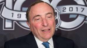 NHL Commissioner Gary Bettman speaks with the media