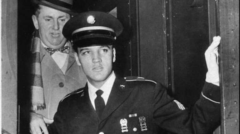 Elvis Presley and Col. Tom Parker step off