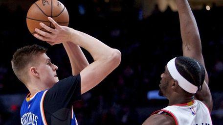 Knicks forward Kristaps Porzingis, left, shoots over Portland