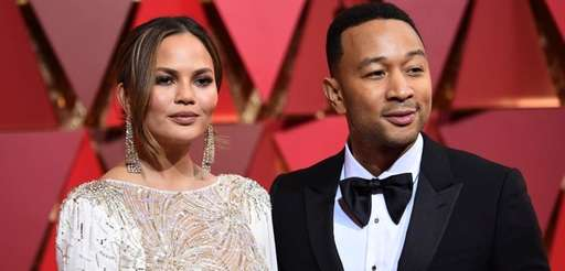 Chrissy Teigen, left, and John Legend arrive at