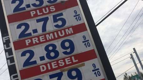 Gasoline prices posted at a station at Pulaski