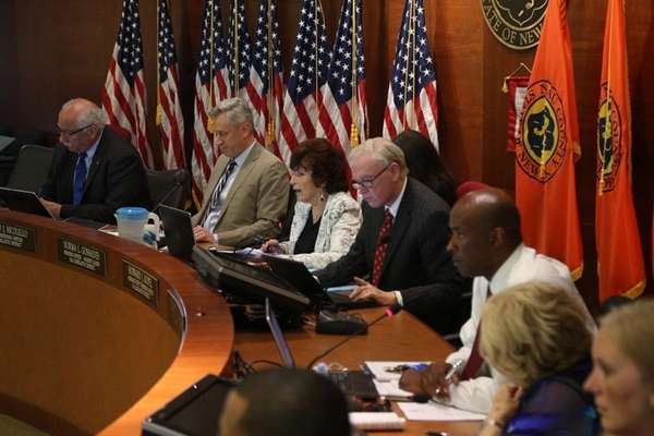 The Nassau County Legislature Rules Committee discuss contracts