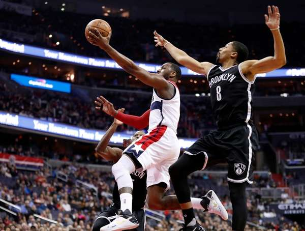 Washington Wizards guard John Wall, center, shoots between