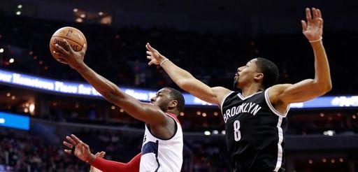 Washington Wizards guard John Wall, center, shoots between